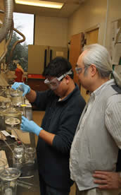 male instructor with male student in lab