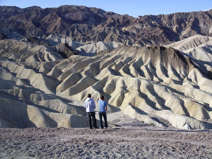 two students looking at zabriski formations