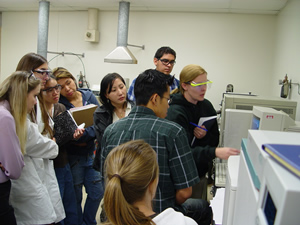 students learning about a GC-Mass Spec Instrument