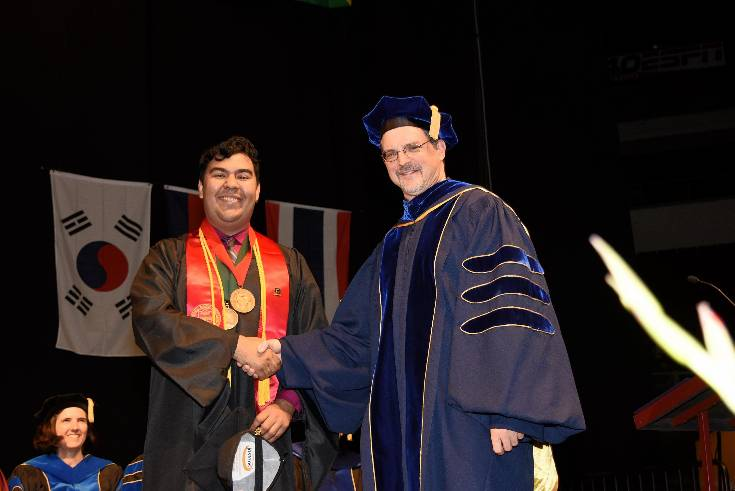 A recognized graduate and Dr. Robert Dundas