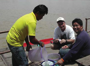 Dr. Steve Blumenshine (center) in Thailand